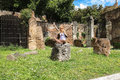 Attractive girl near the picturesque ruins of Rome, Italy Royalty Free Stock Photo