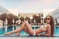 Attractive girl near swimming pool