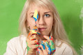 Attractive girl with palette knife and hands in fresh paint Royalty Free Stock Photo