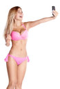 Attractive girl in pink swimsuit taking selfie on the phone. Royalty Free Stock Photo