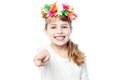 Attractive girl pointing towards camera young beautiful child in colorful flower crown Royalty Free Stock Photography