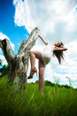 Attractive girl is posing with a stump Royalty Free Stock Photo