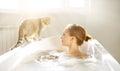 Photo : An Attractive girl relaxing in bath  boy bathrobe