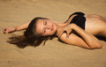Attractive girl relaxing on a sandy beach Stock Photography