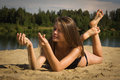 Attractive girl on a sandy beach Stock Photography
