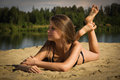 Attractive girl on a sandy beach Royalty Free Stock Photography