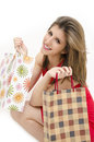 Attractive girl with shoping bag beautiful holding shopping while smiling isolated on white Royalty Free Stock Images