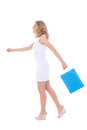 Attractive girl with shopping bags walking isolated on white background Royalty Free Stock Photo