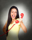Attractive girl shouting at phone on gray background Stock Image