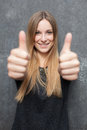 Attractive girl showing thumbs up Royalty Free Stock Photo
