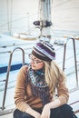 Attractive girl sitting on board Royalty Free Stock Photo