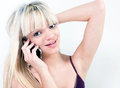 Attractive girl smiling while phoning Stock Photography