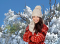 Attractive girl and a snowed tree Stock Images