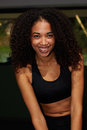 Attractive girl in sport clothes smiling looking to the camera portrait of afro american woman happy with brilliant smile Stock Photo
