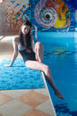 Attractive girl in swimming pool Stock Images