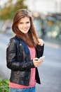 Attractive girl using her smart phone young woman Royalty Free Stock Photography