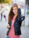 Attractive girl using her smart phone young woman Stock Photography