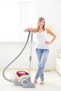 Attractive girl vacuum cleaner Royalty Free Stock Photo
