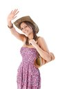 Attractive girl waving smiling at summer Stock Photos