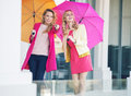 Attractive girlfriends with the colorful umbrellas young Stock Photo