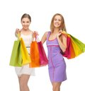Attractive girls holding color shopping bags presents and gifts Royalty Free Stock Photography