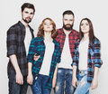 Attractive group of happy young men and women life style happiness people concept hipster style studio shot over white Royalty Free Stock Image