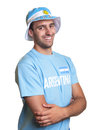 Attractive guy with argentinian jersey and crossed arms laughing at camera Royalty Free Stock Photo