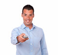 Attractive guy pointing with remote control Royalty Free Stock Photo
