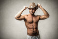Attractive handsome man bared chest wearing a cowboy hat Stock Images