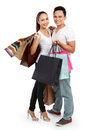 Attractive happy couple carrying shopping bag Stock Photos