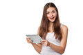 Attractive happy girl in white shirt using tablet. Excited woman with tablet pc, isolated on white background Royalty Free Stock Photo