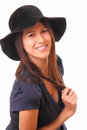 Attractive and happy young woman in a black hat Stock Images