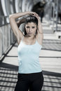 Attractive hispanic brunette woman looking cool and defiant after running workout