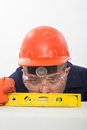 Attractive hispanic construction worker using levelling tool Stock Images