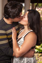 Attractive Hispanic Couple Kissing Outdoors Royalty Free Stock Photography