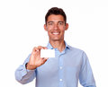 Attractive hispanic man holding a blank card portrait of an business while smiling at you on isolated background copyspace Royalty Free Stock Photography