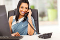 Attractive indian receptionist young talking on the phone Stock Image