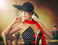 Attractive lady with black hat and red scarf sitting in restaurant Royalty Free Stock Photo