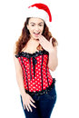 Attractive lady posing with santa cap on female wearing and to camera Royalty Free Stock Image