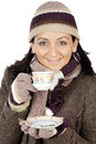 Attractive lady sheltered for the winter drinking a tea cup Stock Images