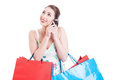 Attractive lady shopper at phone smiling and acting happy Royalty Free Stock Photo