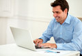 Attractive male entrepreneur working on his laptop