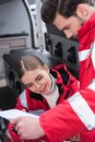 attractive male and female paramedics reading documents in front Royalty Free Stock Photo