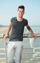 Attractive male smiling at the beach Royalty Free Stock Photo
