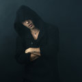 Attractive man in  black hoodie crossed his arms Royalty Free Stock Photo