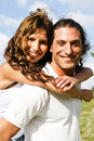 Attractive man carrying woman Royalty Free Stock Photography