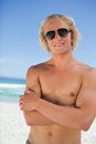 Attractive man crossing his arms while standing in swimsuit Stock Photos