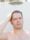 Attractive man having shower outdoors Stock Photography