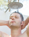 Attractive man having shower outdoors Royalty Free Stock Photography