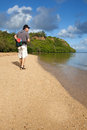 Attractive man hiking kauai beach in his fifties Stock Photos